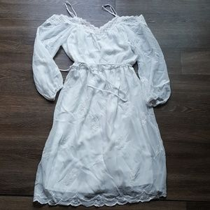 White women's dress with sleeves